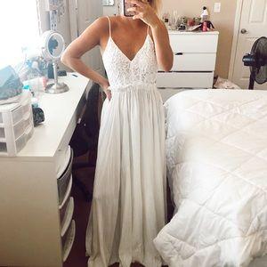 backless white crochet flowy dress